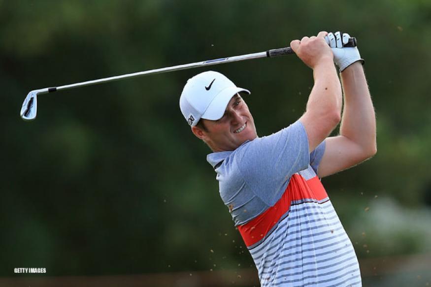 Warren takes clubhouse lead at Dubai championship