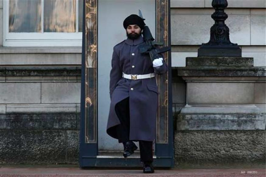 Sikh soldier parades outside Buckingham palace in a turban