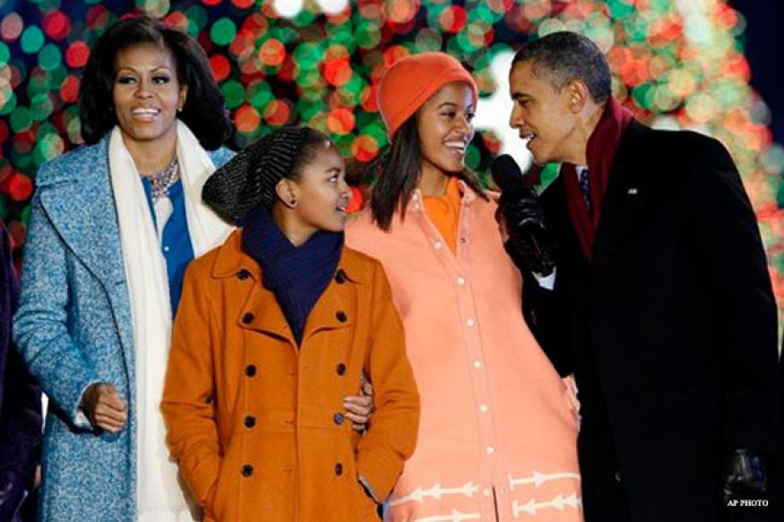 US President Barack Obama sings with Santa Claus