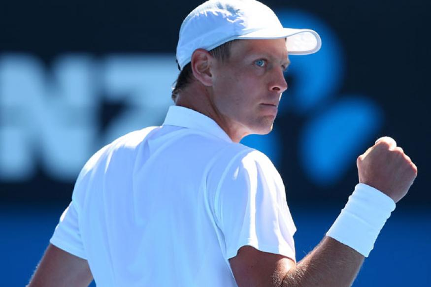 Australian Open: Berdych eases past Russell