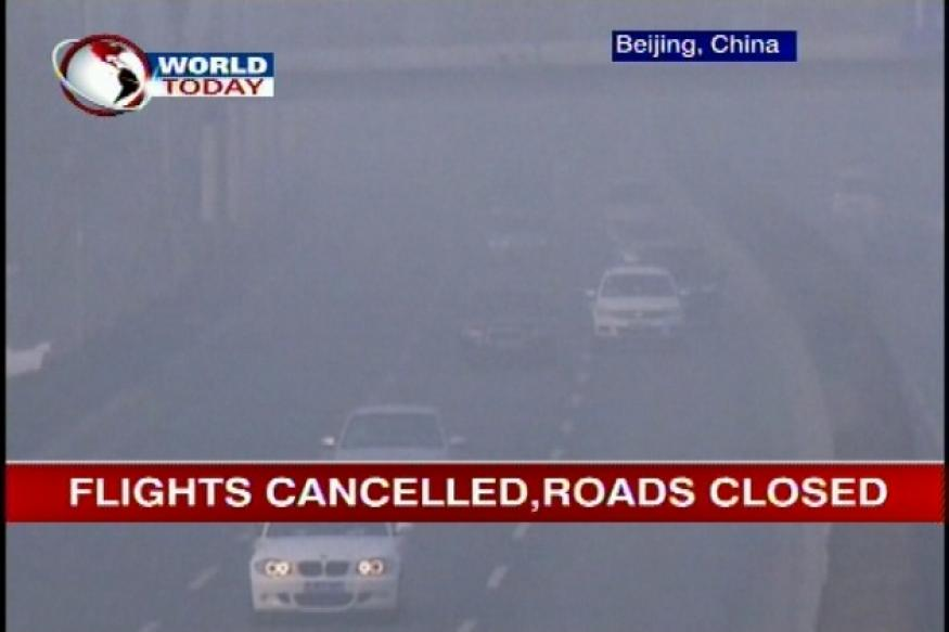 China covered by dense fog; Beijing air hazardous
