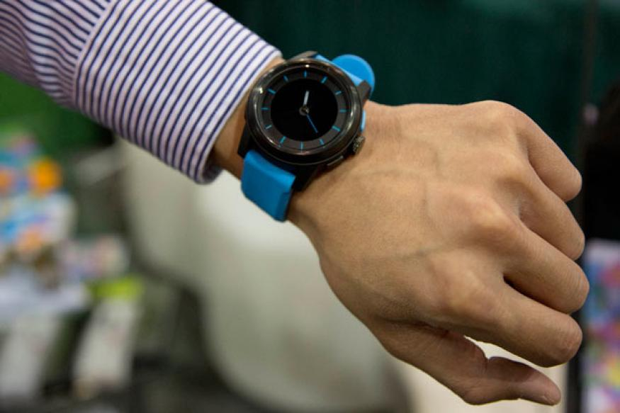 A smartwatch runs for a year on a standard button cell