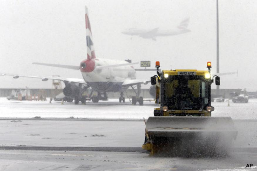 London Heathrow cancels more flights as snow continues