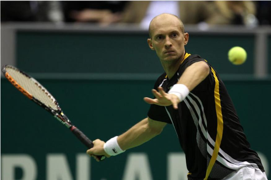 Davydenko, Monfils reach quarterfinals at Qatar Open