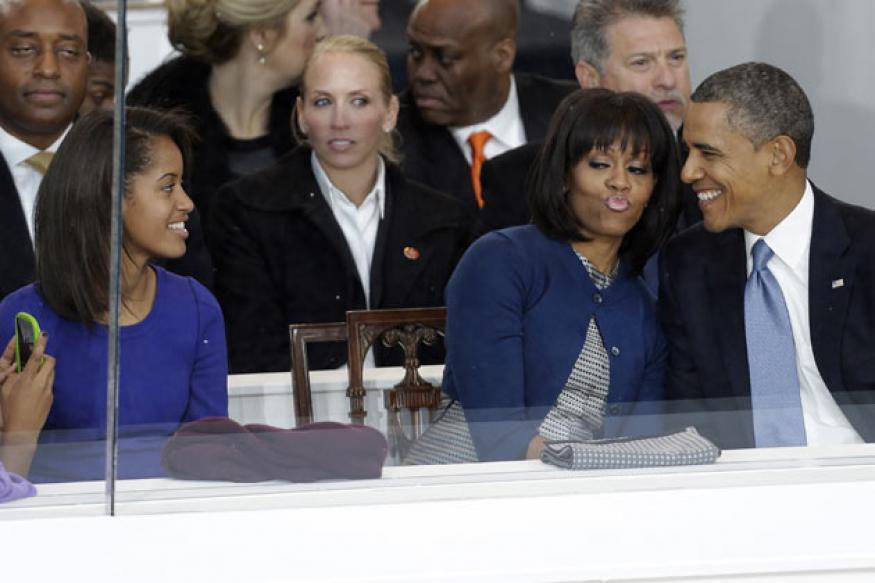 Snapshot: Awww! Sasha clicks photos of Michelle and Barack Obama kissing