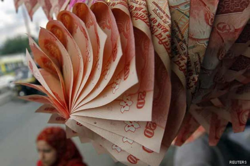 Rupee up 15 paise against dollar in early trade