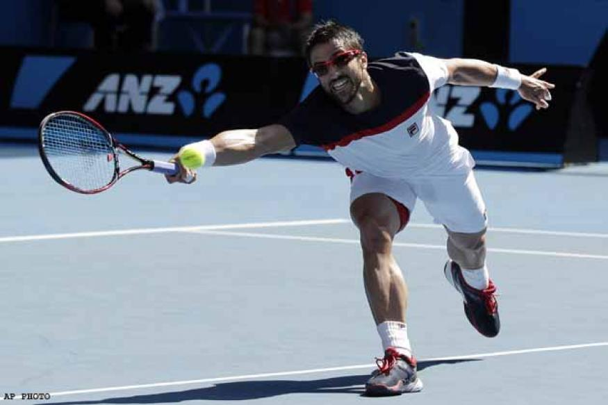 Almagro reaches quarters after Tipsarevic retires