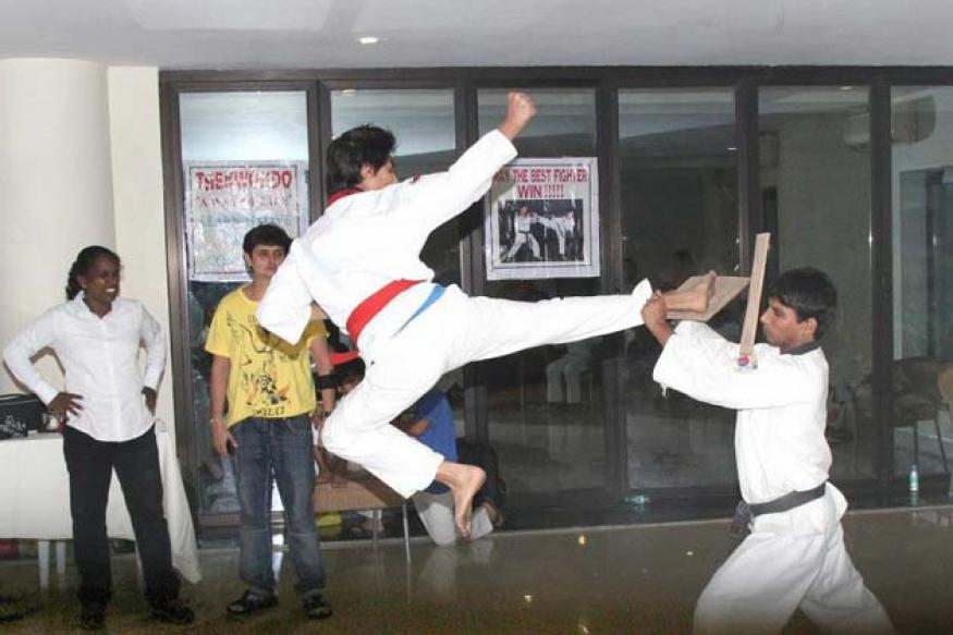 Snapshot: Shah Rukh's son Aryan throws a flying kick