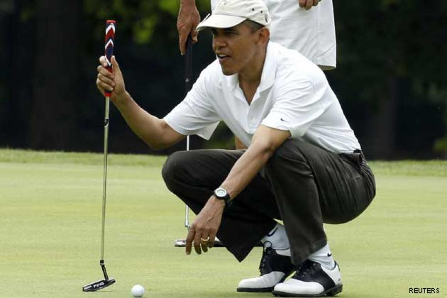 Barack Obama plays golf with Tiger Woods