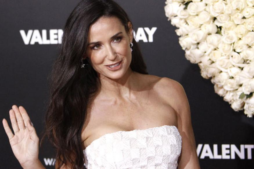 Russell Brand invites Demi Moore on a trip to India