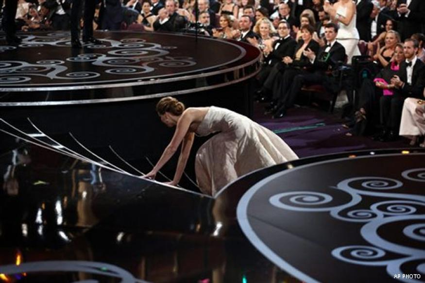 Jennifer Lawrence trips and falls at the Oscars