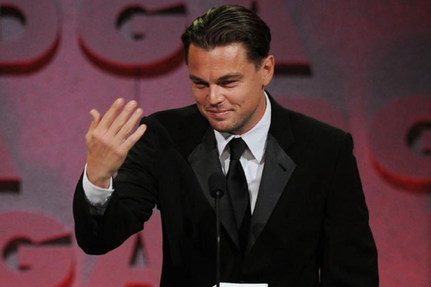 DiCaprio bumps into a topless lady in the sea