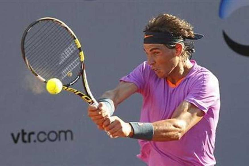 Nadal overcomes slow start to advance in Chile