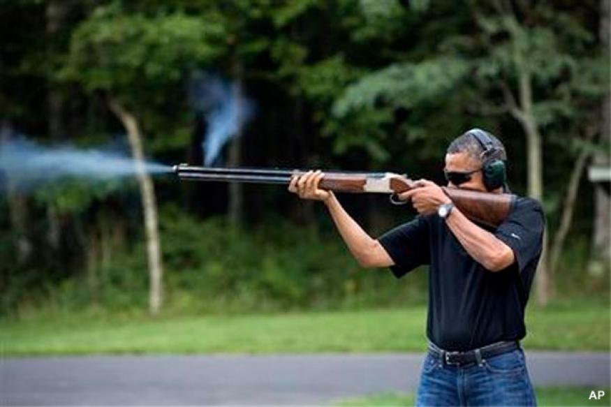 White House releases photo of Obama firing gun