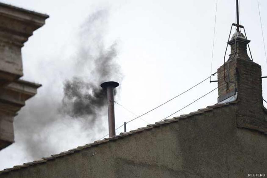 Black smoke signals inconclusive papal vote