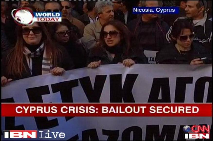 Cyprus girds for run on banks after sealing bailout