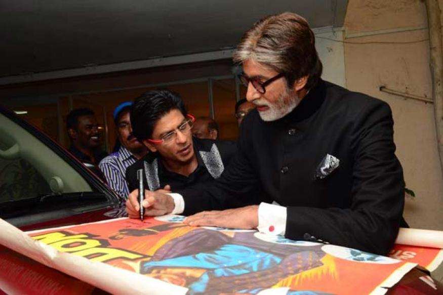 Snapshot: Amitabh signs a poster of 'Don' for SRK