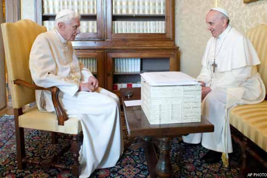 Pope Francis meets Benedict, tells him 'we're brothers'