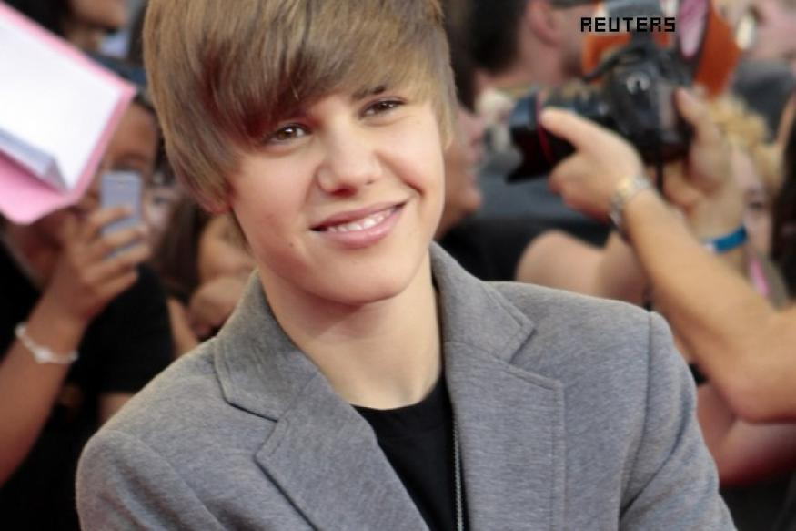 Record bosses warn Justin Bieber after concert fiasco