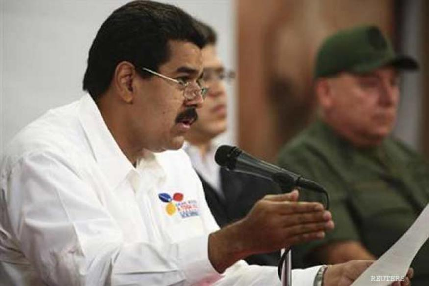"Venezuela's Maduro urges Obama to halt ""plot"" against rival"