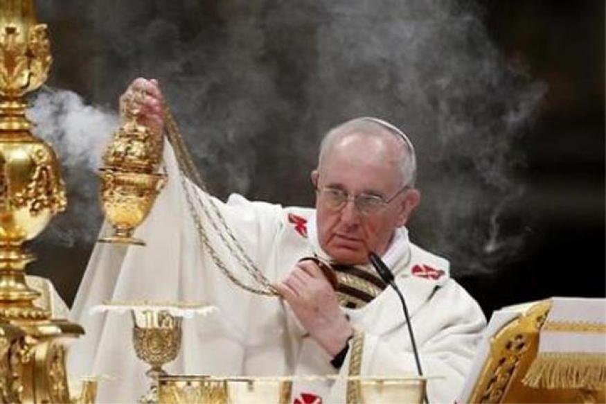 Pope leads Catholics into Easter at vigil service in St Peter's