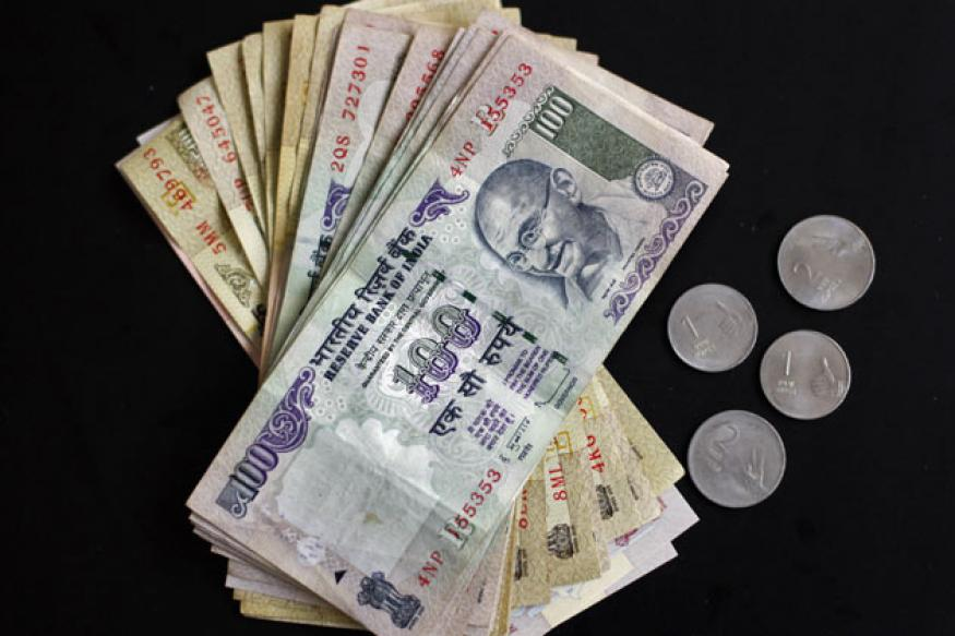 Rupee down 4 paise against dollar in late morning trade