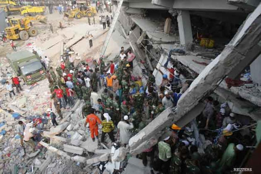 Bangladesh mourns as building collapse toll rises to 164