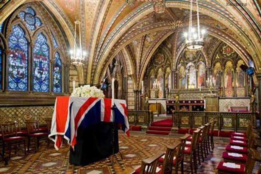 Thatcher's body lies in chapel as funeral debate rages
