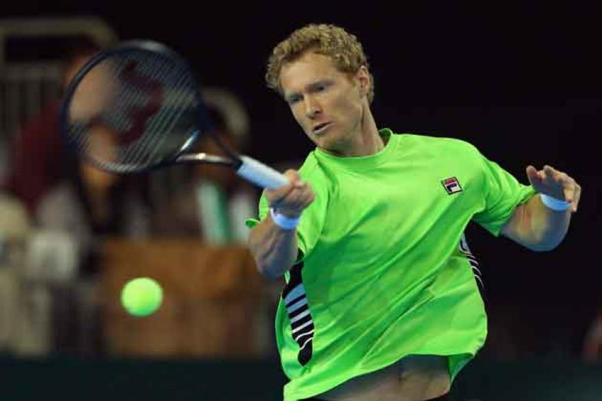 Ferrer shocked in Barcelona, Nadal eases through