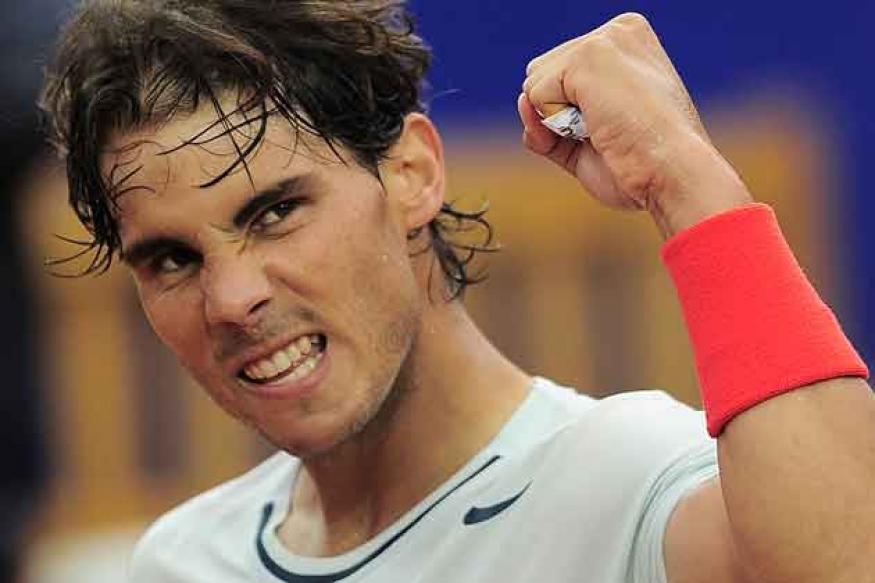Nadal routs Raonic to close in on eighth Barcelona title