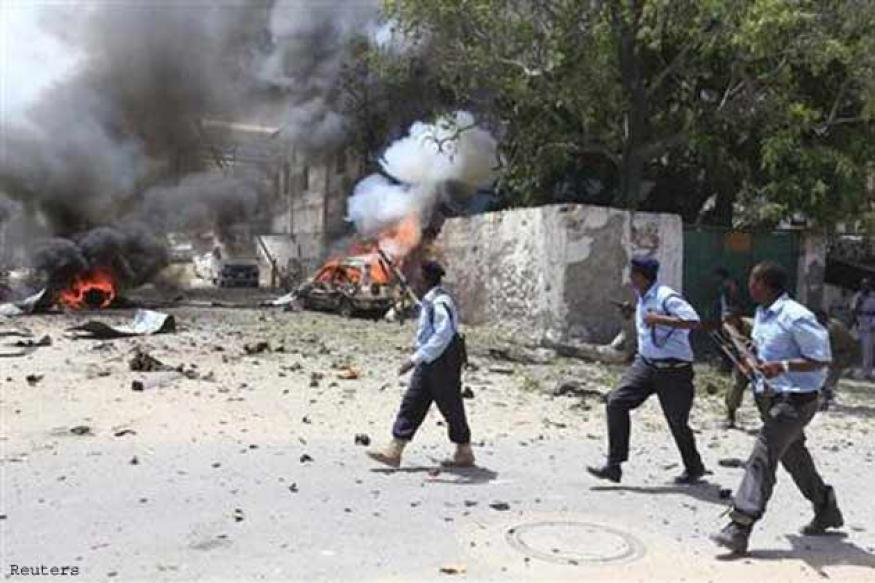 Bombs and gun battles kill at least 19 in Somali capital