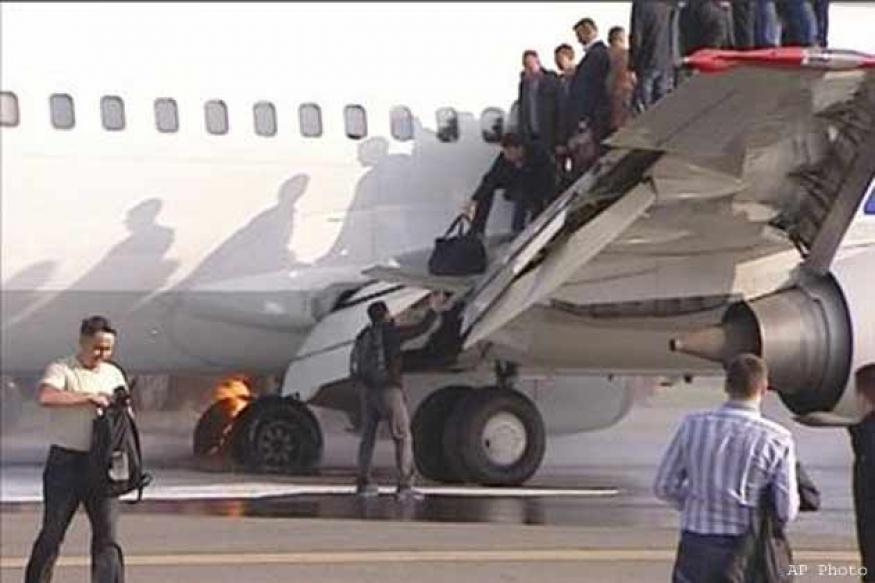 Plane catches fire during landing at airport in Moscow