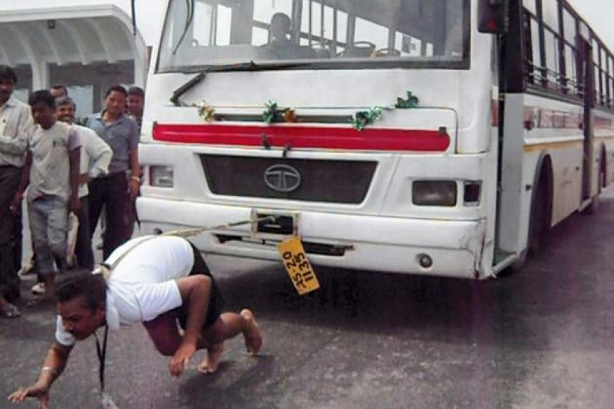 Snapshot: Unbelievable! Assam police constable pulls transportation bus with his hair