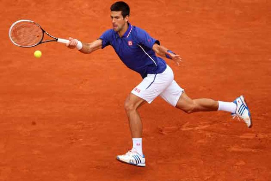 Djokovic beats Pella to reach French Open round three