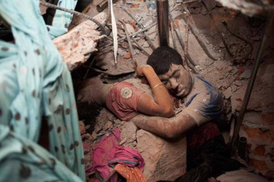 Haunting photo of Bangladesh couple in final embrace after building collapse goes viral