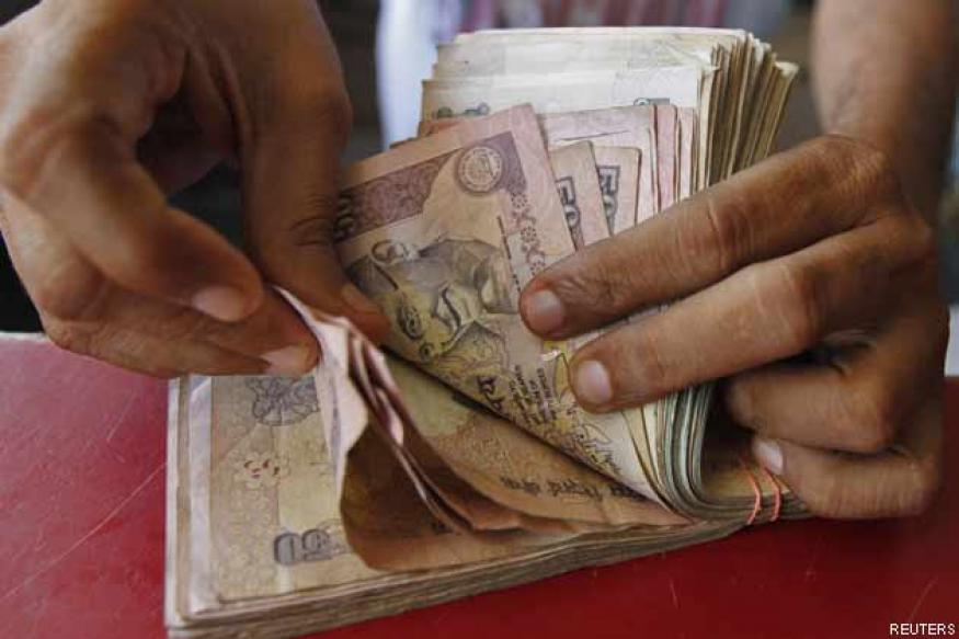 Rupee trims initial losses vs dollar