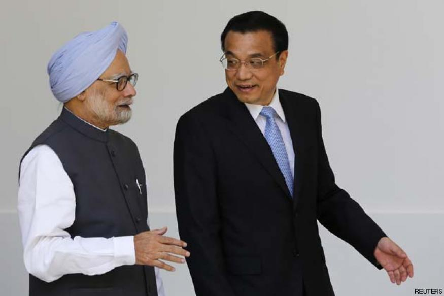 With wary eye on the US, China courts India