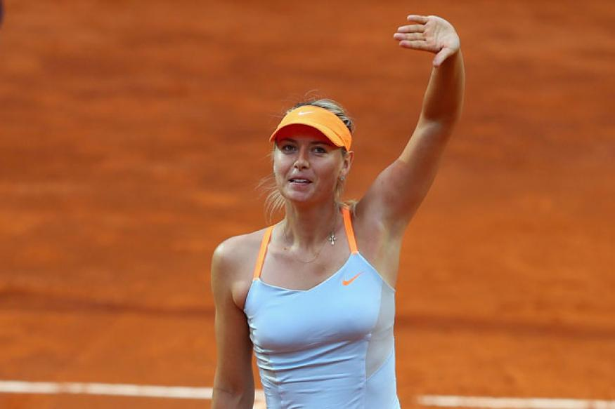 Murray retires with back pain; Sharapova wins at Rome