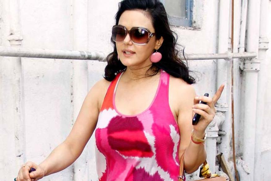 Snapshot: Tacky or trendy? Preity Zinta's all pink slacks, tank top and earrings