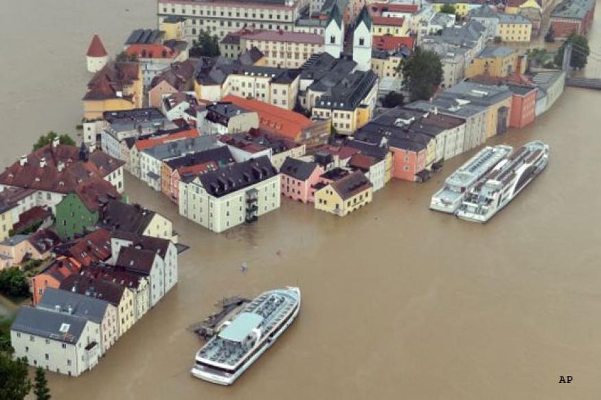 Floodwaters surge farther north in Germany