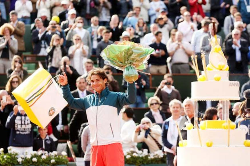 Birthday boy Rafael Nadal reaches last eight at Roland Garros