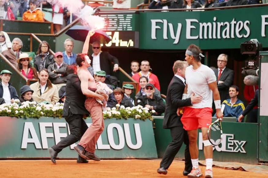 Protesters, one letting off a flare, interrupt French Open final