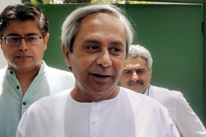 Naveen distributes free mobile phone sets among farmers