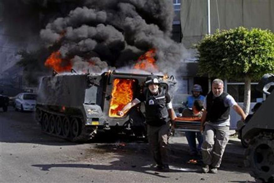Sectarian clashes among Sunnis, Shiites at its worst in Sidon; 12 soldiers killed, 50 injured