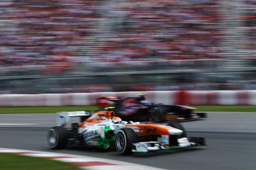 Force India's 100th GP earns them seven points