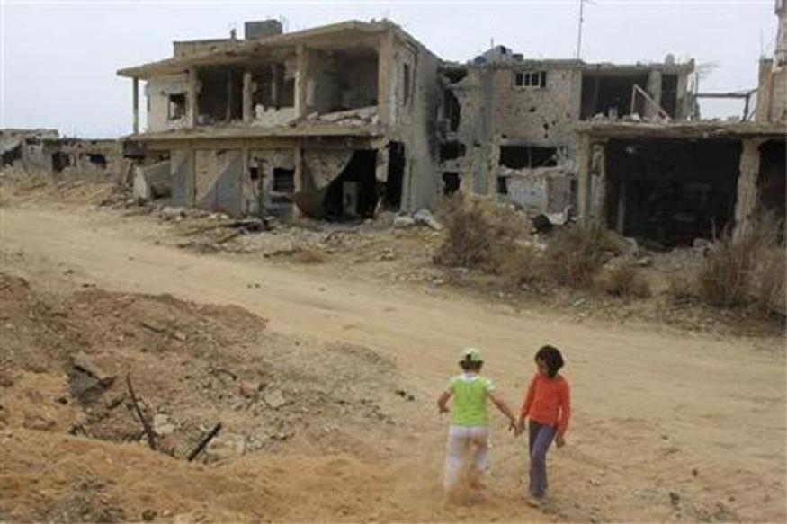 Syrian government and rebels recruit children to fight, says UN