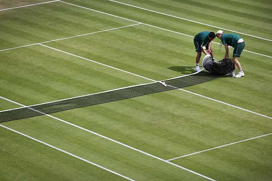 Wimbledon groundsman 100 percent happy despite tumbles