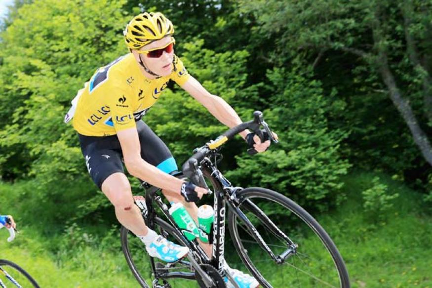 Chris Froome rides to victory in 100th Tour de France