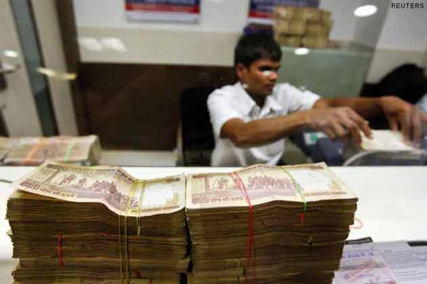 Rupee rebounds from record lows, up 7 paise to 60.40 vs dollar