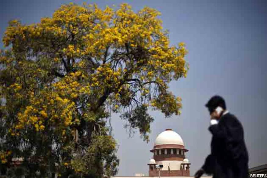 Ownership of minerals vests with owner of land: SC